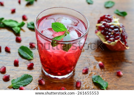 Pomegranate drink with mint and ice, horizontal, selective focus ...