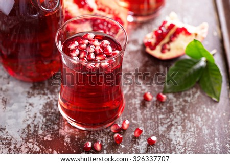 Pomegranate drink with sparkling water fall cold beverage - stock photo