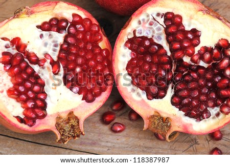 Pomegranate fruit rustic on wood background. Winter fruits. - stock photo