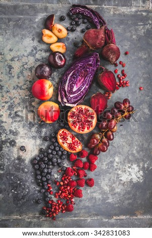 Pomegranate grapefruit raspberries, blueberries beet smoothie recipe. Colorful purple vegan bowl food concept. rustic style. Rustic purple,red and violet food collage. - stock photo
