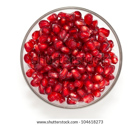 pomegranate in bowl isolated on white - stock photo