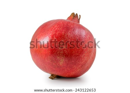 Pomegranate is photographed on the white background - stock photo