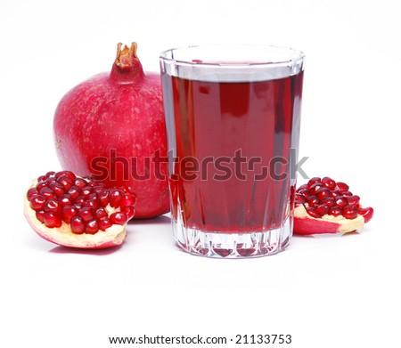 pomegranate juice and fruit over white - stock photo