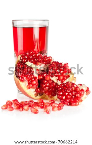 Pomegranate juice. Fresh ripe pomegranate and glass of juice isolated on white background - stock photo