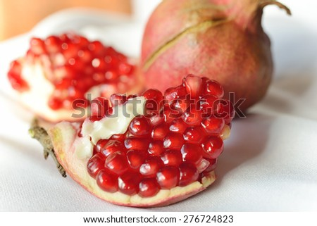 Pomegranate on white background. Beautiful delicious fruit - stock photo