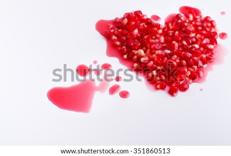 pomegranate seeds background in the shape of heart - stock photo