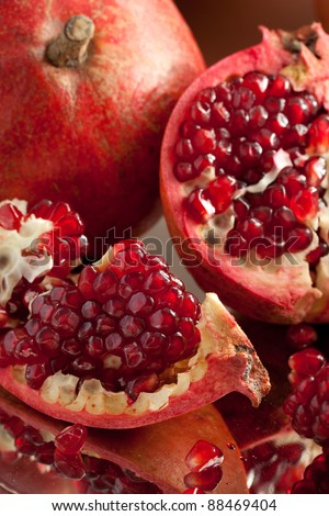 Pomegranate slices and seeds on silver salver - stock photo