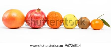 pomegranates and citrus fruits isolated on a white background. - stock photo