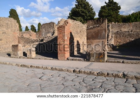 POMPEII, ITALY - AUGUST 15, 2014: Famous antique ruins of Pompeii, Italy. Pompeii was destroyed and buried with ash and pumice after Vesuvius eruption in 79 AD. - stock photo
