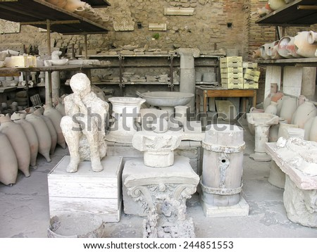 POMPEII, ITALY - MAY 05, 2006:  Body of man preserved in plaster cast who died in AD 79 Vesuvius eruption in Pompeii, Italy. Man suffocated by volcanic gasses later preserved with plaster - stock photo