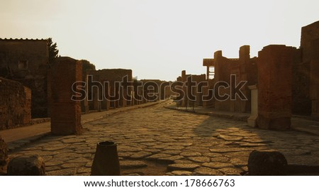 POMPEII, Italy - SEPTEMBER 30,2011: Ruins on sunset in Pompeii Italy.Tourists visiting the old roman town of Pompeii, destroyed by volcanic eruption of Mt Vesuvius - stock photo
