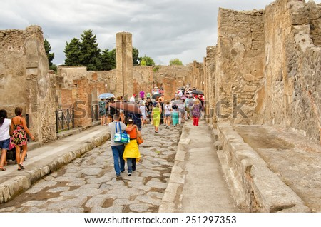 POMPEII, ITALY - SEPTEMBER 1: tourists visit Pompeii - an ancient Roman city that was ruined from the eruption of Mount Vesuvius in 79 AD. Italy, Pompeii, sep 1, 2014. - stock photo