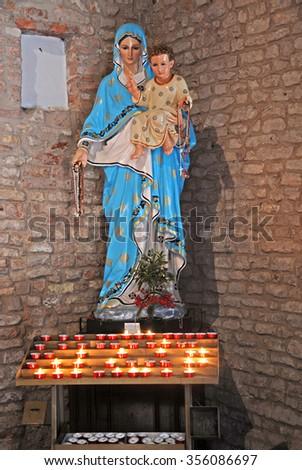 Pomposa Abbey Saint Mary church interior Madonna statue. - stock photo