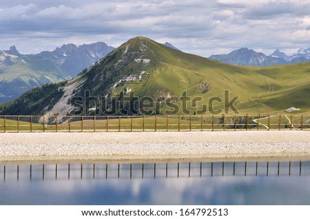 Pond and mount Saint-Jacques at La Plagne, commune in the Tarentaise Valley,Savoie department and Rh�´ne-Alpes region in France - stock photo