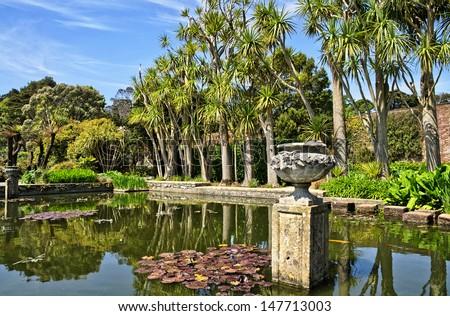 Pond and trees in Logan Botanic Gardens - stock photo