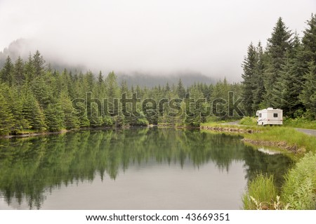 pond with passing motor home - stock photo