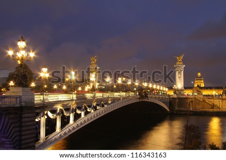 Pont Alexandre III and Hotel des Invalides at evening. Paris night scenes - stock photo