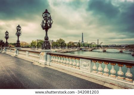 Pont Alexandre III bridge in Paris, France. Seine river and Eiffel Tower. Vintage - stock photo