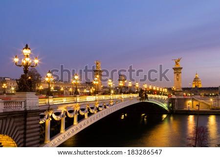 Pont Alexandre III in Paris at dusk - stock photo