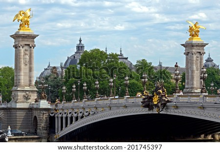 Pont Alexandre III, Paris, France. The bridge, with its Art Nouveau lamps, cherubs, nymphs and winged horses at either end, was built between 1896 and 1900.  - stock photo