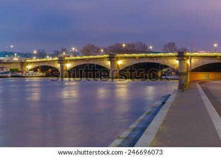 Pont de la Concorde at night illumination in Paris, France - stock photo