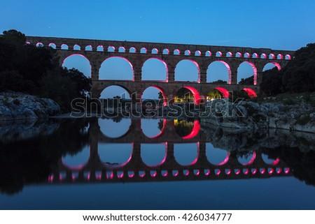 Pont du Gard at night. Vers-Pont-du-Gard, Gard, France. - stock photo