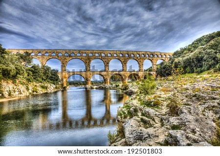 Pont du Gard is an old Roman aqueduct near Nimes in Southern France. - stock photo