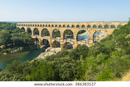 Pont du Gard is an old Roman aqueduct, southern France near Avignon - stock photo