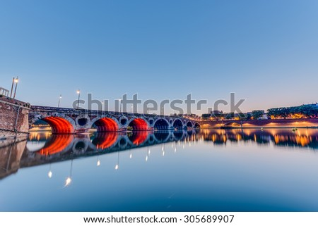 Pont Neuf, the 220 meters long bridge with its 7 arches was inaugurated in 1659 in Toulouse, Haute-Garonne, Midi Pyrenees, southern France. - stock photo