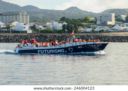 PONTA DELGADA, AZORES, PORTUGAL AUGUST - 13 : Recreational Boat with whale watching expedition in the Atlantic Ocean off the coast of Ponta Delgada, on the island of Sao Miguel in August 13, 2014 - stock photo