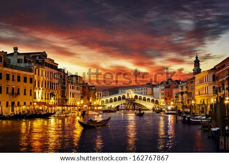 Ponte Rialto and gondola at sunset in Venice, Italy - stock photo