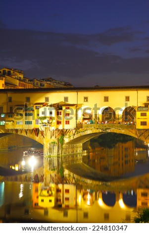 Ponte Vecchio bridge in Florence at night with copyspace, Italy - stock photo