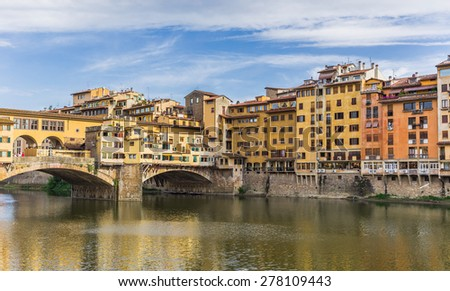 Ponte Vecchio, old bridge, medieval landmark on Arno river and its reflection. Florence, Tuscany, Italy. - stock photo