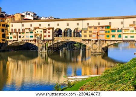 Ponte Vecchio with reflections in the Arno river, Florence, Italy - stock photo