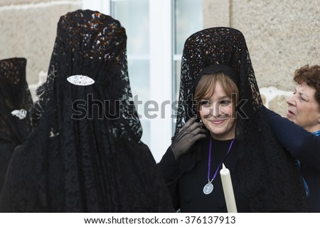 PONTEVEDRA, SPAIN - APRIL 3, 2015: A group of pious women, with Spanish mantilla, wait for the start of the Holy Week processions. - stock photo