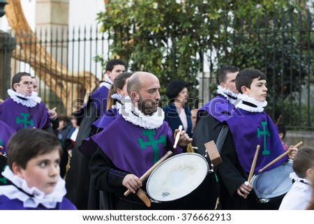 PONTEVEDRA, SPAIN - APRIL 3, 2015: Band of wind and percussion music, members of a religious brotherhood, parading during the Easter processions. - stock photo