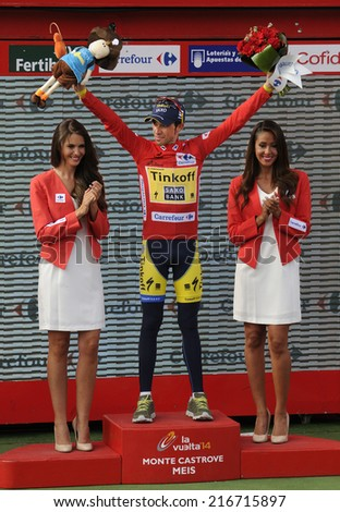 PONTEVEDRA, SPAIN - SEPTEMBER 11: Alberto Contador on the podium to receive the award red jersey of the leader. Tour of Spain 2014 (Vuelta Espana). Stage 18 (A Estrada - Monte Castrove)  09-11-2014  - stock photo