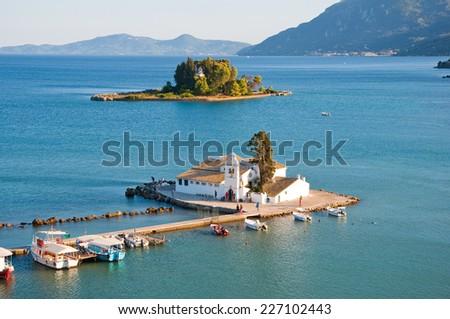 Pontikonisi and Vlacheraina Orthodox monastery seen from the hilltop of Kanoni on the island of Corfu, Greece. - stock photo