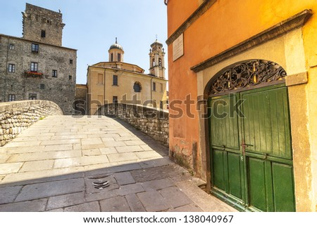 Pontremoli (Massa Carrara, Tuscany, Italy) - Ancient bridge and colorful buildings - stock photo