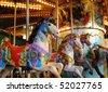 Pony rides on a merry-go-round carousel. - stock photo