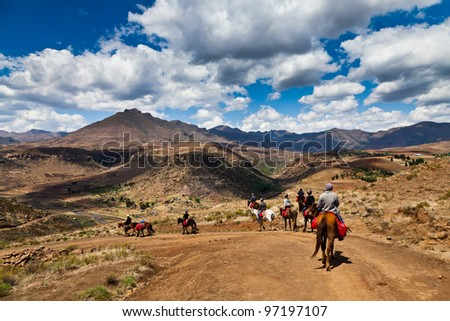 Pony trail adventure in the mountains of africa - stock photo