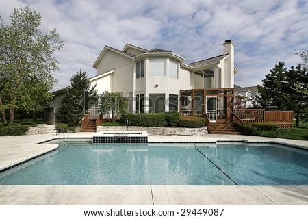 Pool and deck of large home - stock photo