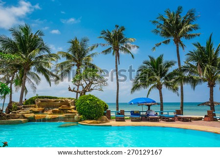 Pool and palms on sea shore. Thailand, Koh Chang, Klong Prao beach - stock photo