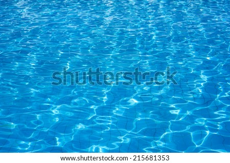 Pool clear blue water surface - stock photo