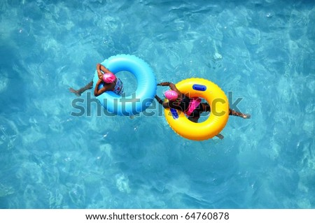 Pool Float / pool rings, room for your text - stock photo