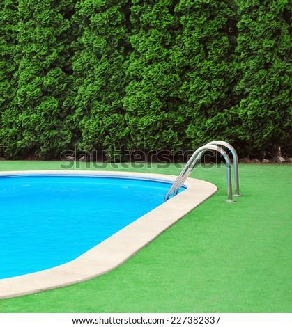 Pool in the garden - stock photo