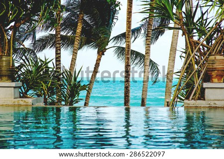 Pool on a tropical beach - vacation background, Koh Samui, Thailand - stock photo