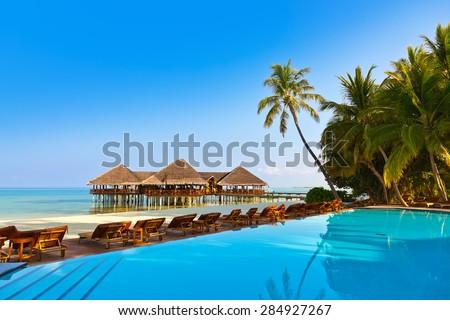 Pool on tropical Maldives island - nature travel background - stock photo