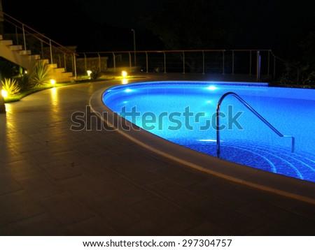 Pool. Oval pool with night illumination. - stock photo