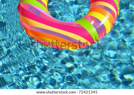 Pool ring / float in swimming pool. - stock photo
